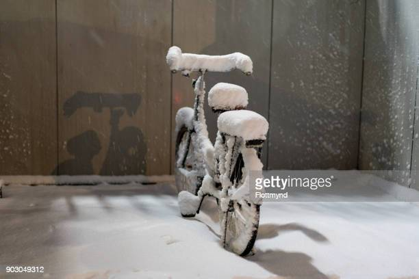 Bicycle covered with snow in winter