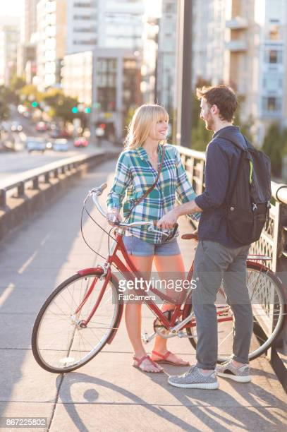 bicycle date on bridge - railing stock photos and pictures