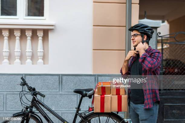 bicycle delivery. copy space. - bicycle messenger stock pictures, royalty-free photos & images