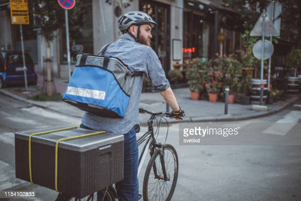 bicycle delivery - bicycle messenger stock pictures, royalty-free photos & images