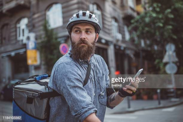 bicycle delivery - delivery person stock pictures, royalty-free photos & images