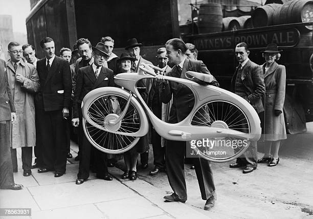 Bicycle designer BG Bowden with his new bicycle which he is taking to the offices of the Council of Industrial Design London for inclusion in the...