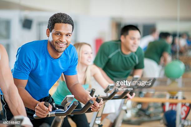bicycle exercising exercise class - male animal stock pictures, royalty-free photos & images