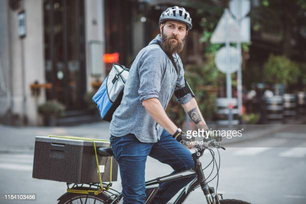 bicycle food delivery - bicycle messenger stock pictures, royalty-free photos & images