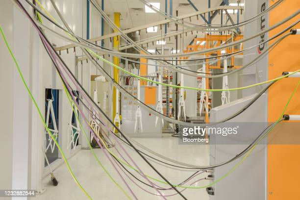 Bicycle frames move along an overhead conveyor in the paint area of a Kent Bicycles production facility in Manning, South Carolina, U.S., on...