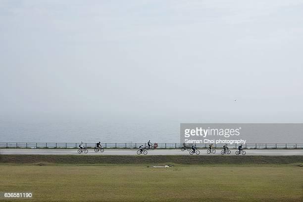 bicycle fun at saemangeum seawall, yellow sea, korea - seawall stock pictures, royalty-free photos & images