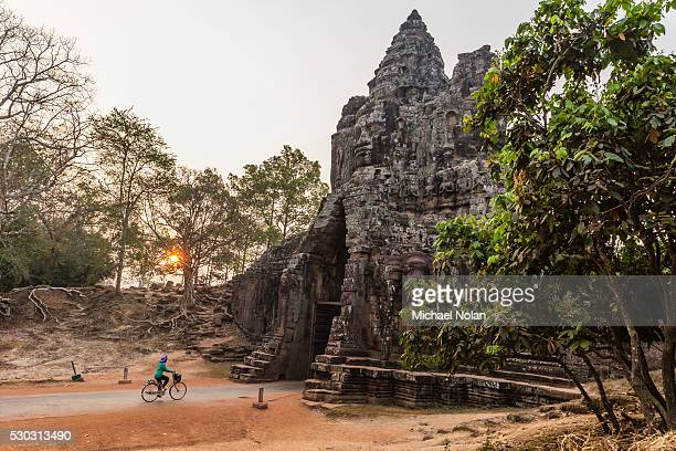 Bicycle going through the South Gate in Angkor Thom at sunrise, Angkor, UNESCO World Heritage Site, Siem Reap Province, Cambodia, Indochina, Southeast Asia, Asia