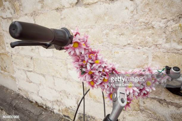 Bicycle handlebar decorated with flowers, vintage