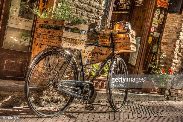 Bicycle in front of a San Gimignano restaurant, Italy