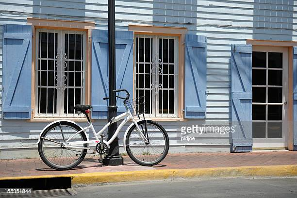 bicycle in front of wooden townhouse on key west florida - key west stock photos and pictures