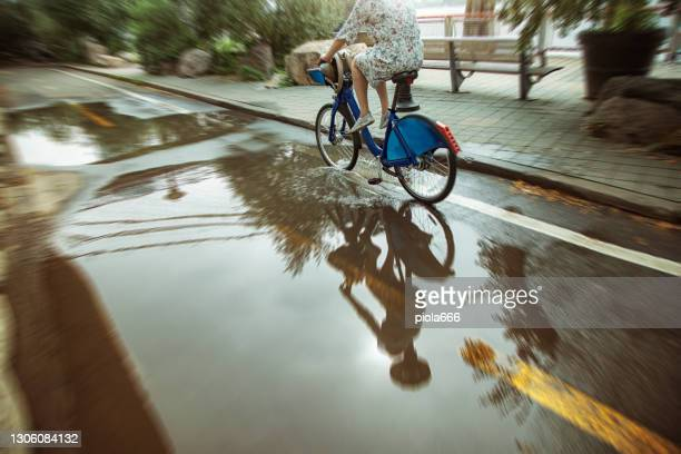 bicycle in new york: under the brooklyn bridge in rainy day - brooklyn new york stock pictures, royalty-free photos & images