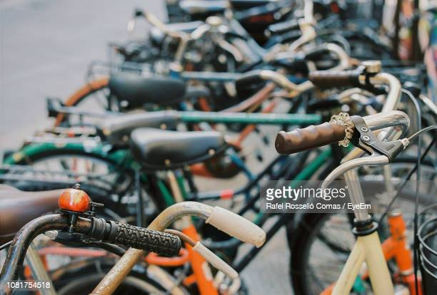 bicycle in parking lot - bicycle parking station stock photos and pictures