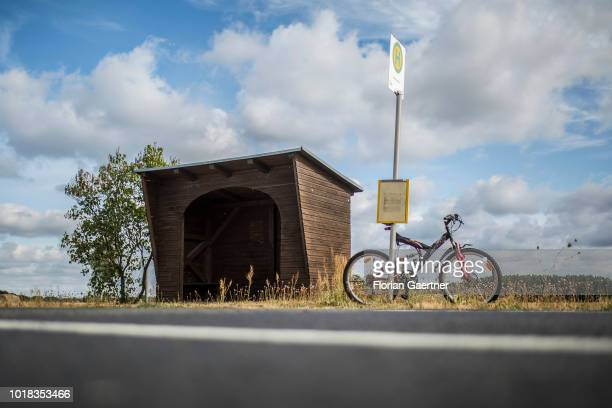 A bicycle is captured in front of a bus station in a rural area on August 15 2018 in KleinOelsa Germany