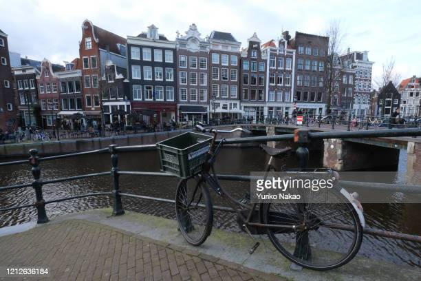 A bicycle is parked along a canal on March 14 2020 in Amsterdam Netherlands