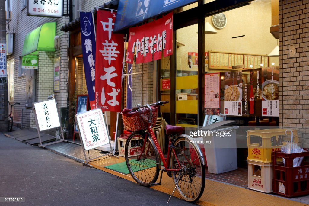 A bicycle is parked in front of a ramen noodle shop in Yokohama, Japan, on Saturday, Feb. 3, 2018. Japans economy expanded for an eighth quarter, with its gross domestic product (GDP) grew at an annualized rate of 0.5 percent in the three months ended Dec. 31, but the pace of growth fell sharply and missed expectations. Photographer: Takaaki Iwabu/Bloomberg via Getty Images