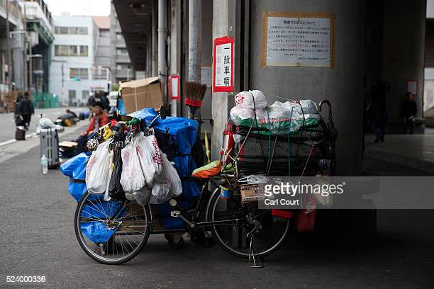 A bicycle laden with belongings is parked in the slum area of Kamagasaki on April 23 2016 in Osaka Japan Kamagasaki a district in Japan's second...