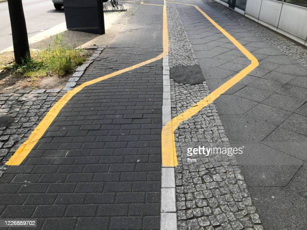 bicycle lane with detour - バリケード ストックフォトと画像