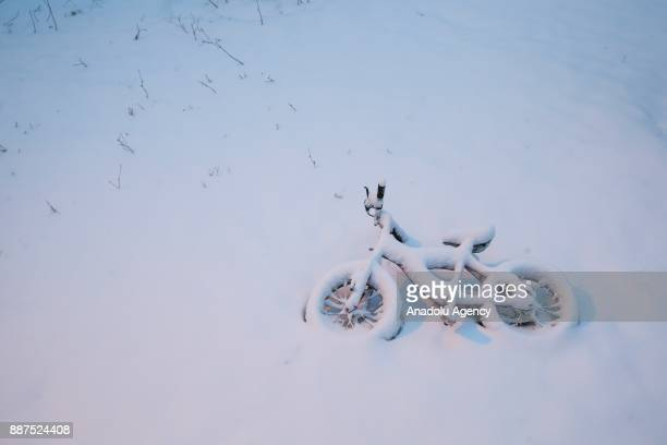 A bicycle lays flat on the ground under snow in Van Turkey on December 07 2017