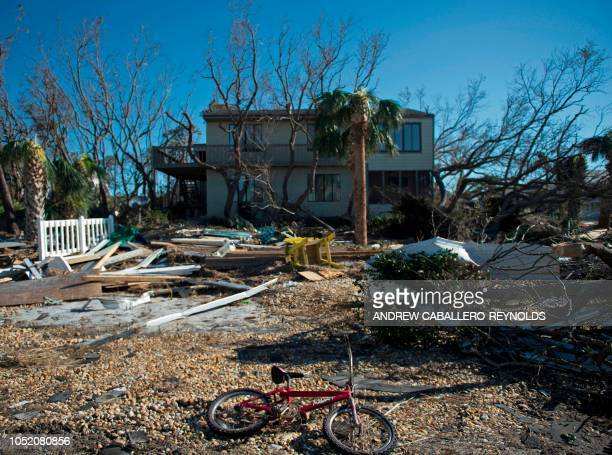 A bicycle lays in front of a destroyed beach house in Port St Joe beach Florida on October 13 three days after Hurricane Michael hit the area Since...