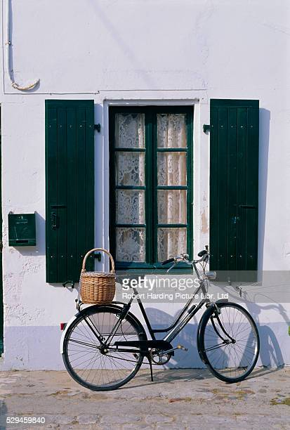 Bicycle Leaning Against a Wall
