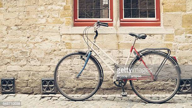 Bicycle leaning against old wall, vintage