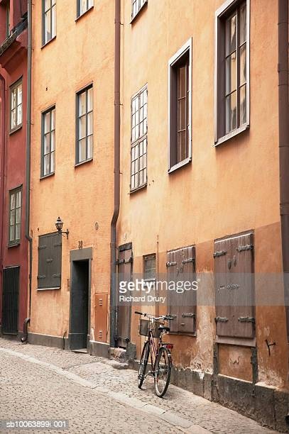 Bicycle leaning against wall in street of old town