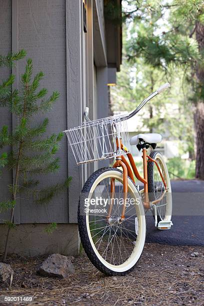 Bicycle leaning on corner of house