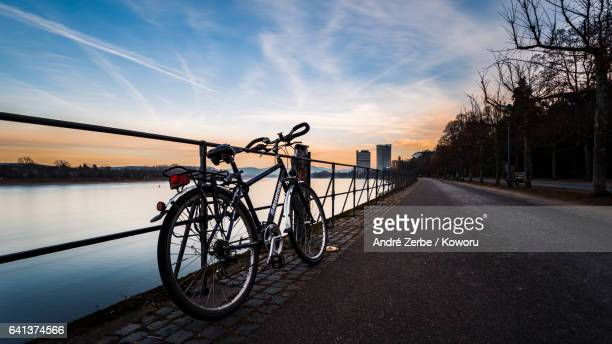 bicycle leaning on the handrail in Bonn next to the Rhine river