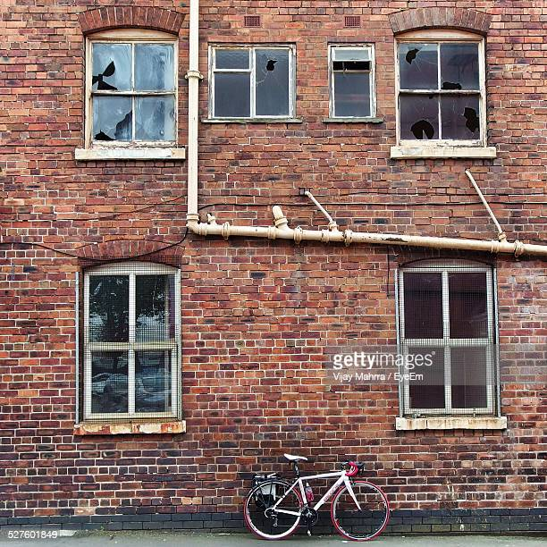 Bicycle Leaning On Wall Of Abandoned Residential Building