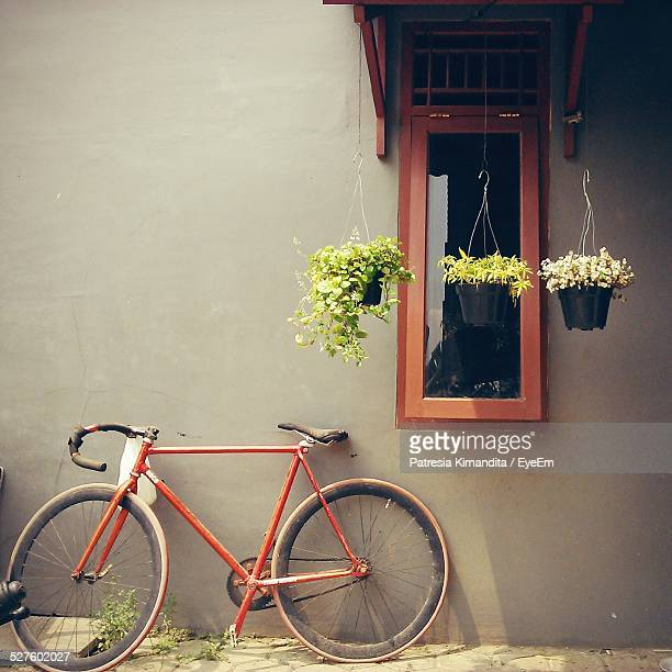 Bicycle Leaning On Wall Of House