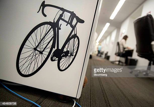 A bicycle logo is affixed to a cubicle wall at the Social Tables Inc headquarters in Washington DC US on Thursday Aug 14 2014 Success stories like...