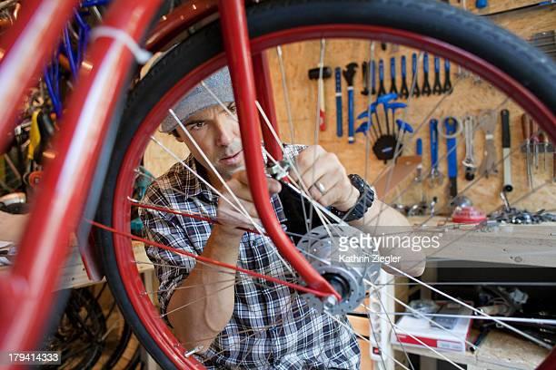 bicycle mechanic at work, fitting drum brake