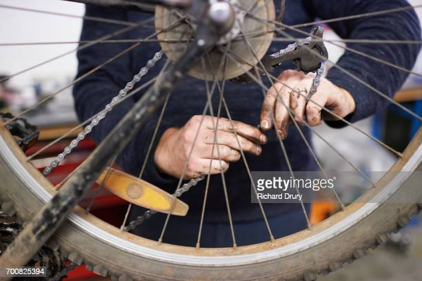 bicycle mechanic at work - adjusting stock photos and pictures