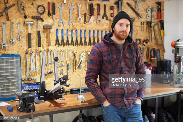 Bicycle mechanic in his workshop