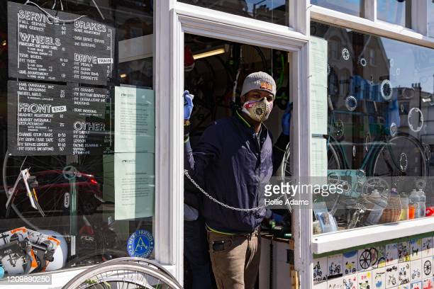 Bicycle mechanic Jesse Cummings at work at Micycle in Stroud Green on April 14 2020 in London United Kingdom The Coronavirus pandemic has spread to...