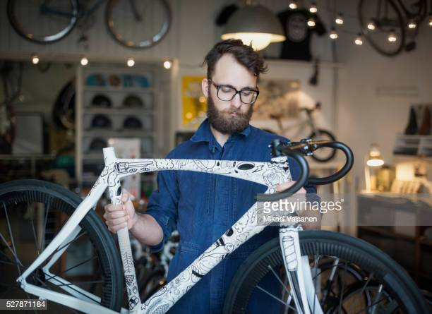 bicycle mechanic with ultra light racer - customised stock photos and pictures