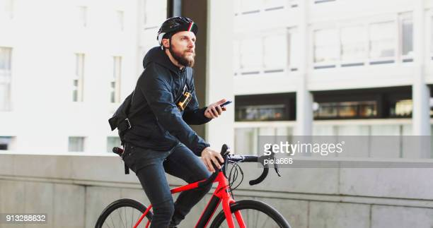 bicycle messenger: commuter with road bicycle in the city - ecchi biker stock pictures, royalty-free photos & images