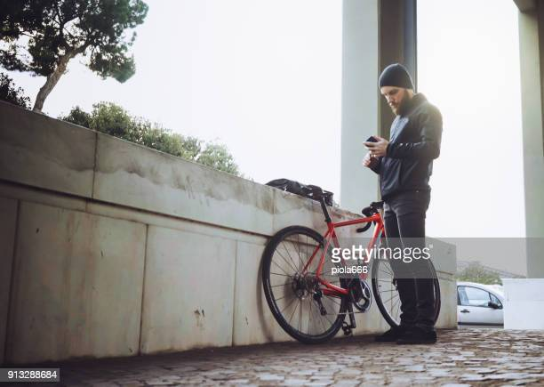 Bicycle messenger: commuter with road bicycle in the city