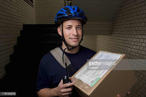 A bicycle messenger delivering a package