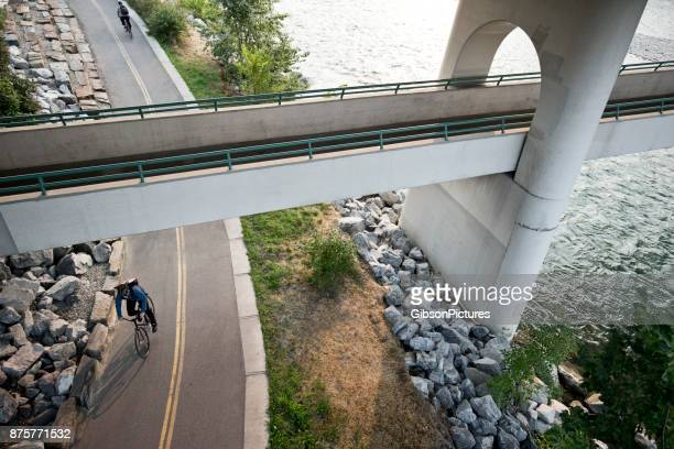 bicycle messenger - bow river stock pictures, royalty-free photos & images