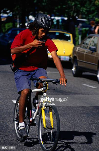 Bicycle Messenger Riding on a City Street