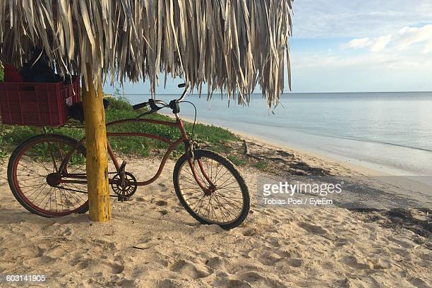 Bicycle On Beach Against Sky
