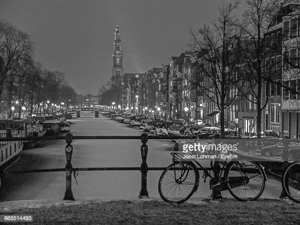 Bicycle On Bridge Over Frozen Amstel River In City