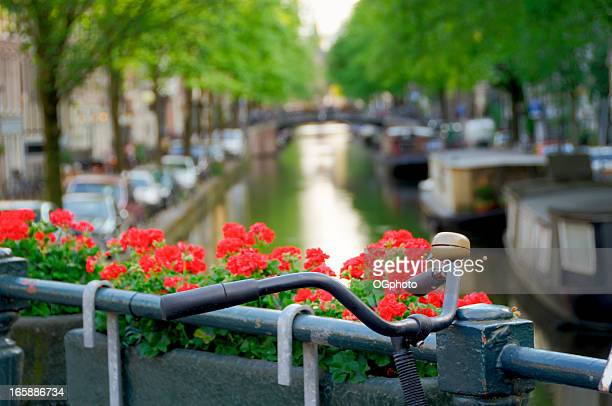 bicycle on canal bridge - ogphoto stock pictures, royalty-free photos & images