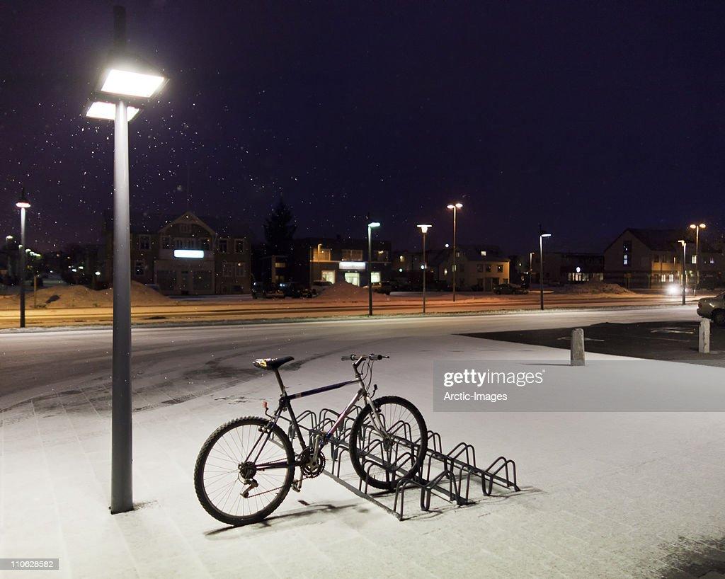 Bicycle on rack in winter, Akureyri, Iceland : Stock Photo