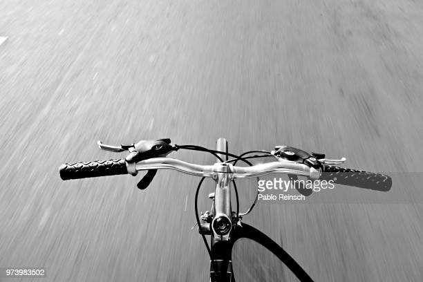 bicycle on road - handlebar stock photos and pictures