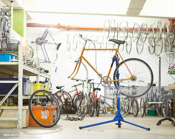 Bicycle on stand in workshop.
