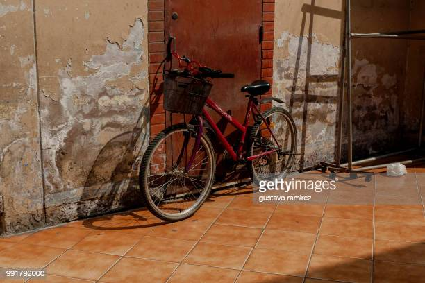 Bicycle On Street Against dirty Wall