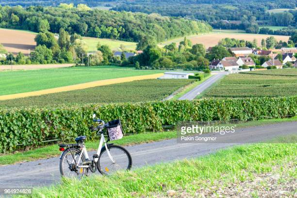 Bicycle on the road in champagne vineyards at montagne de reims countryside village background