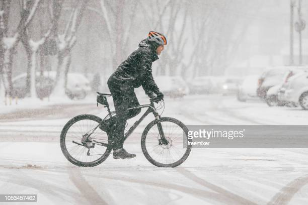 bicycle on the snow - cycling stock pictures, royalty-free photos & images